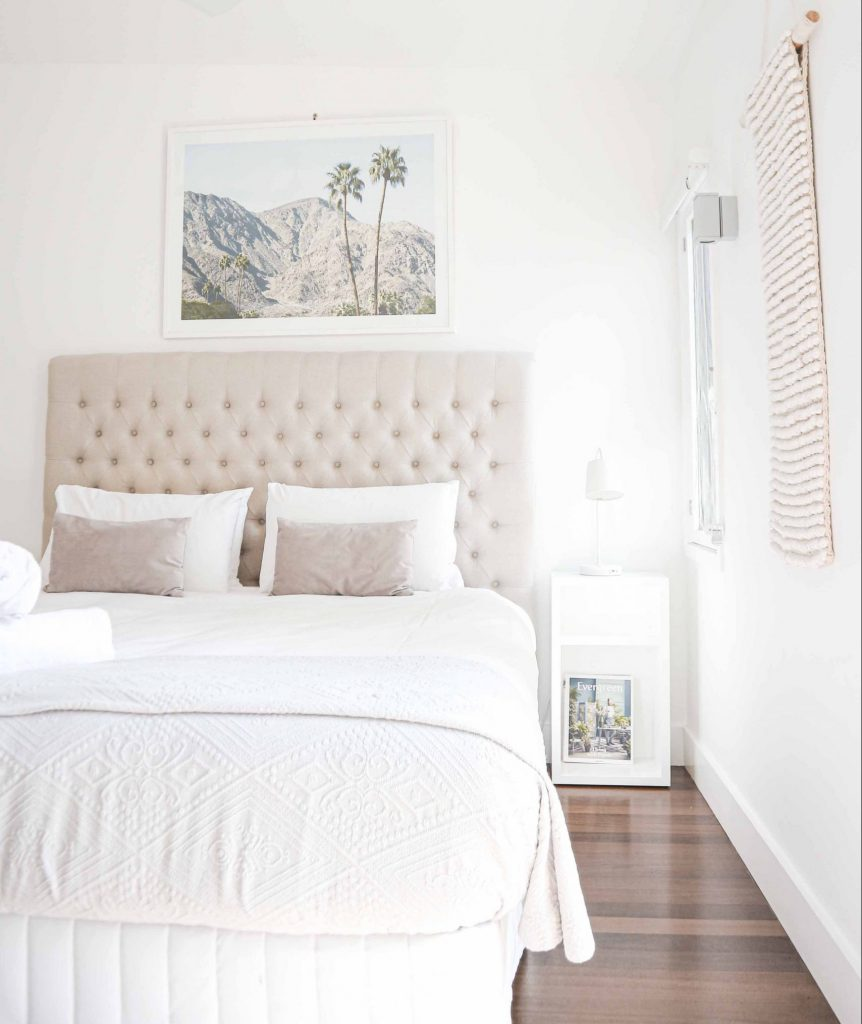 Bright room with white bedding